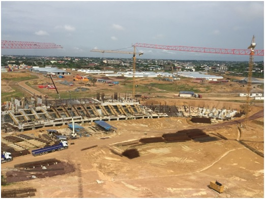 Same view of previous picture, West grandstands under construction